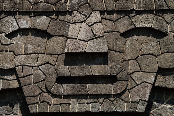 face made out of stone for gift of grief article