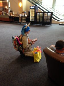 Image of a Brony in convention centre lobby