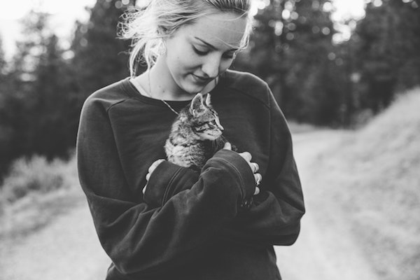 image of girl hugging her cat in bw-self-care
