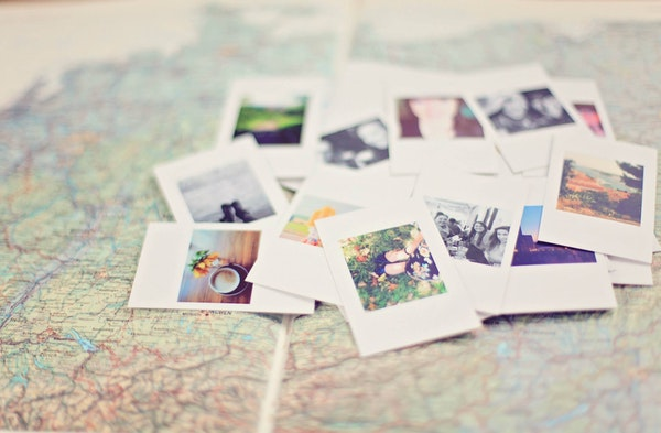 image of polaroid photos on a world map-my representation of a life map