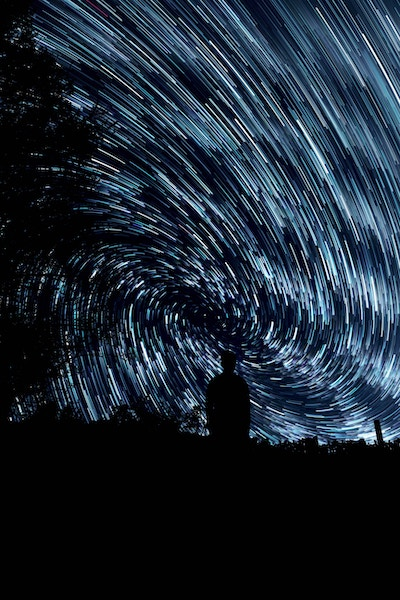 Image of stars in time-lapse. Looks like space travel. Like star trek tachyon particles
