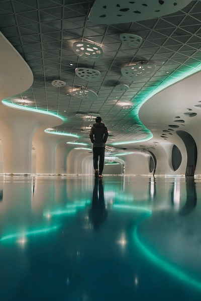 Image of guy walking through cool blue walkway-for Path of Letting Go post